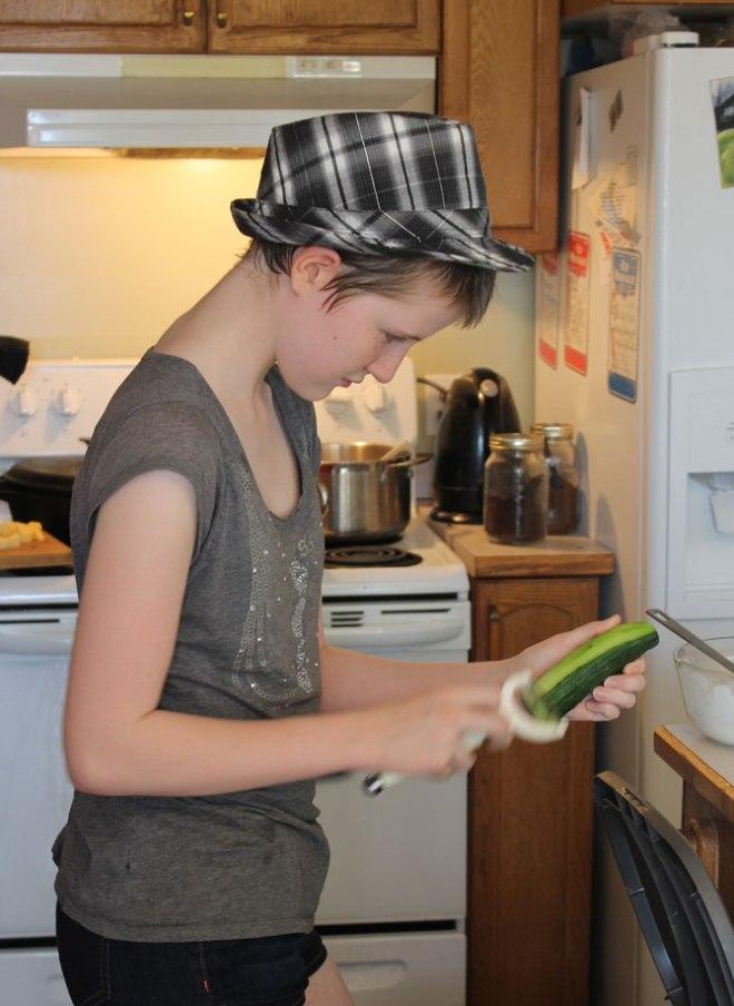 Peeling the cucumbers
