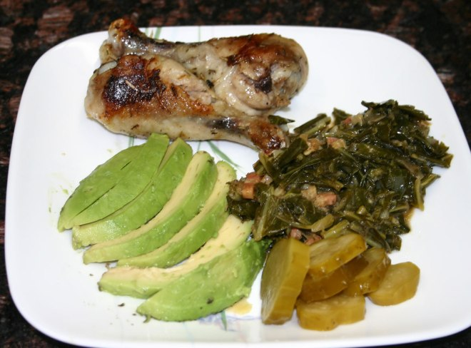 2 Chicken drumsticks, collard greens with bacon, half a sliced avocado and some pickles